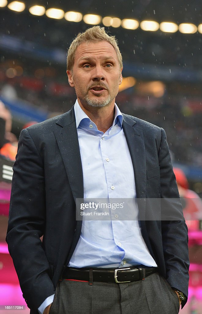 Thorsten Fink, head coach of Hamburg ponders during the Bundesliga match between FC Bayern Muenchen and Hamburger SV at Allianz Arena on March 30, 2013 in Munich, Germany.