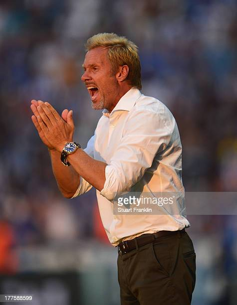 Thorsten Fink head coach of Hamburg reacts during the Bundesliga match between Hertha BSC and Hamburger SV at Olympiastadion on August 24 2013 in...