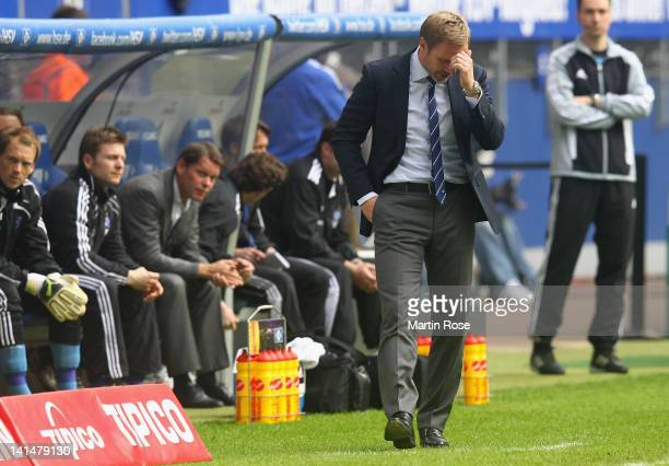 Thorsten Fink head coach of Hamburg reacts during the Bundsliga match between Hamburger SV and SC Freiburg at Imtech Arena on March 17 2012 in...