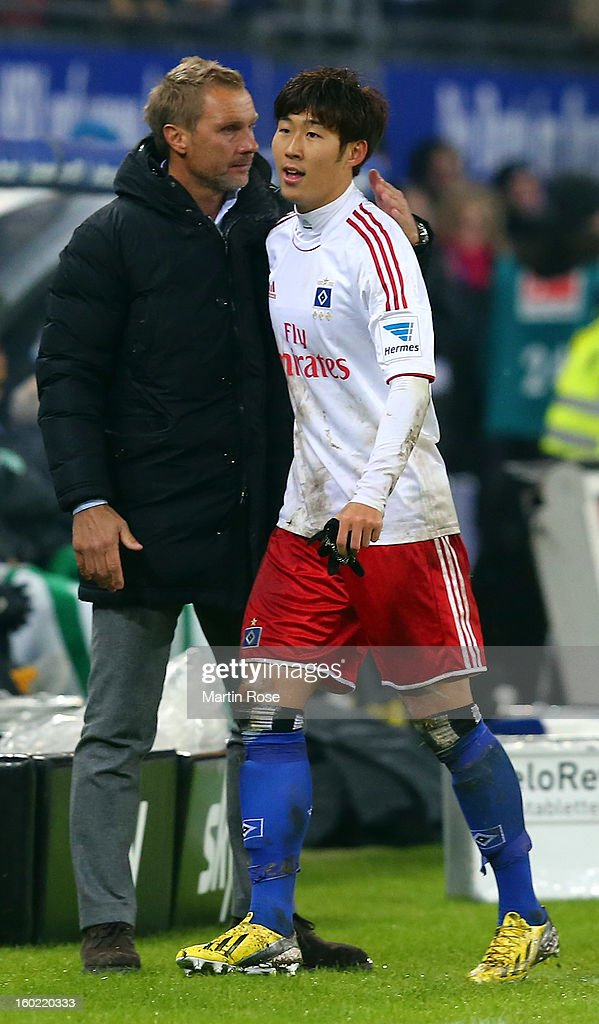 Thorsten Fink (L), head coach of Hamburg talks to Heung Min Son during the Bundesliga match between Hamburger SV and SV Werder Bremen at Imtech Arena on January 27, 2013 in Hamburg, Germany.