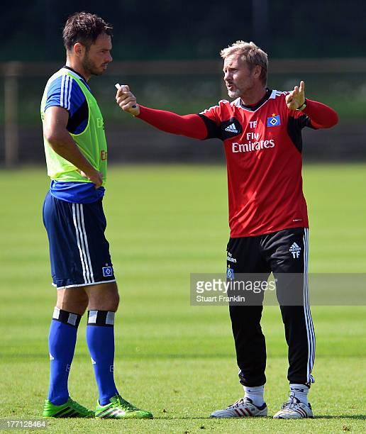 Thorsten Fink head coach of Hamburg talks with Heiko Westermann on of Hamburger SV on August 21 2013 in Hamburg Germany