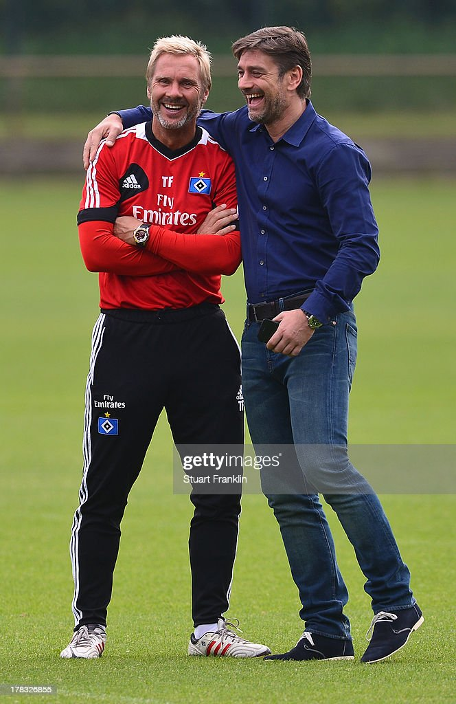 <a gi-track='captionPersonalityLinkClicked' href=/galleries/search?phrase=Thorsten+Fink&family=editorial&specificpeople=2381735 ng-click='$event.stopPropagation()'>Thorsten Fink</a>, head coach of Hamburg talks with Oliver Kreuzer, sports director of Hamburg during the training session of Hamburger SV on August 29, 2013 in Hamburg, Germany.