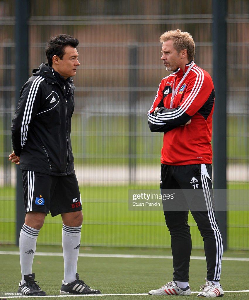 Thorsten Fink, head coach of Hamburg talks with under 23 coach, Rodolfo Cardoso during a training session of Hamburger SV on April 18, 2013 in Hamburg, Germany.