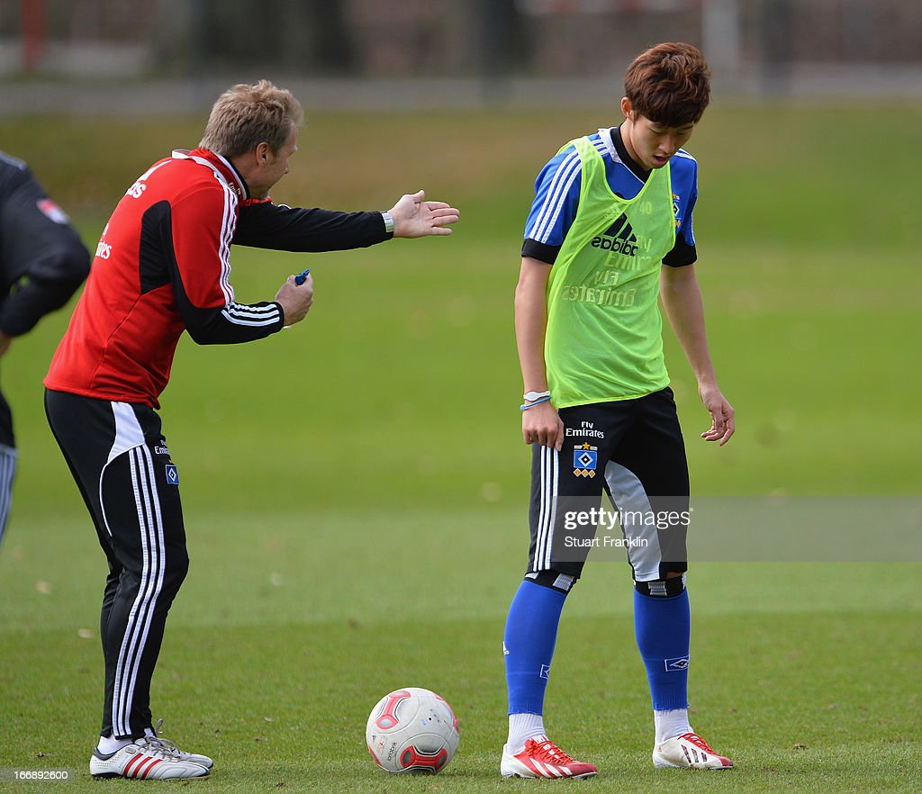 Thorsten Fink, head coach of Hamburg with Heung Min Son during a training session of Hamburger SV on April 18, 2013 in Hamburg, Germany.