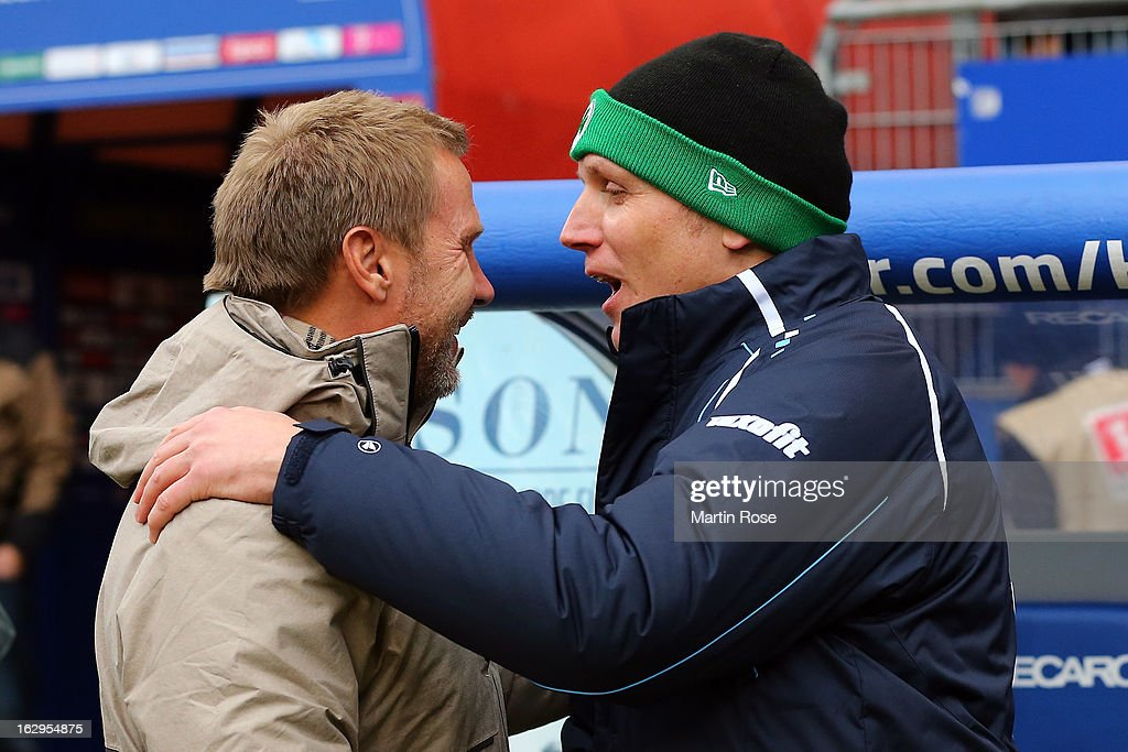 Thorsten Fink (l), head coach of Hamburger SV, and Ludwig Preis, head coach of Greuther Fuerth shake hands prior to the Bundesliga match between Hamburger SV and Greuther Fuert at Imtech Arena on March 2, 2013 in Hamburg, Germany.