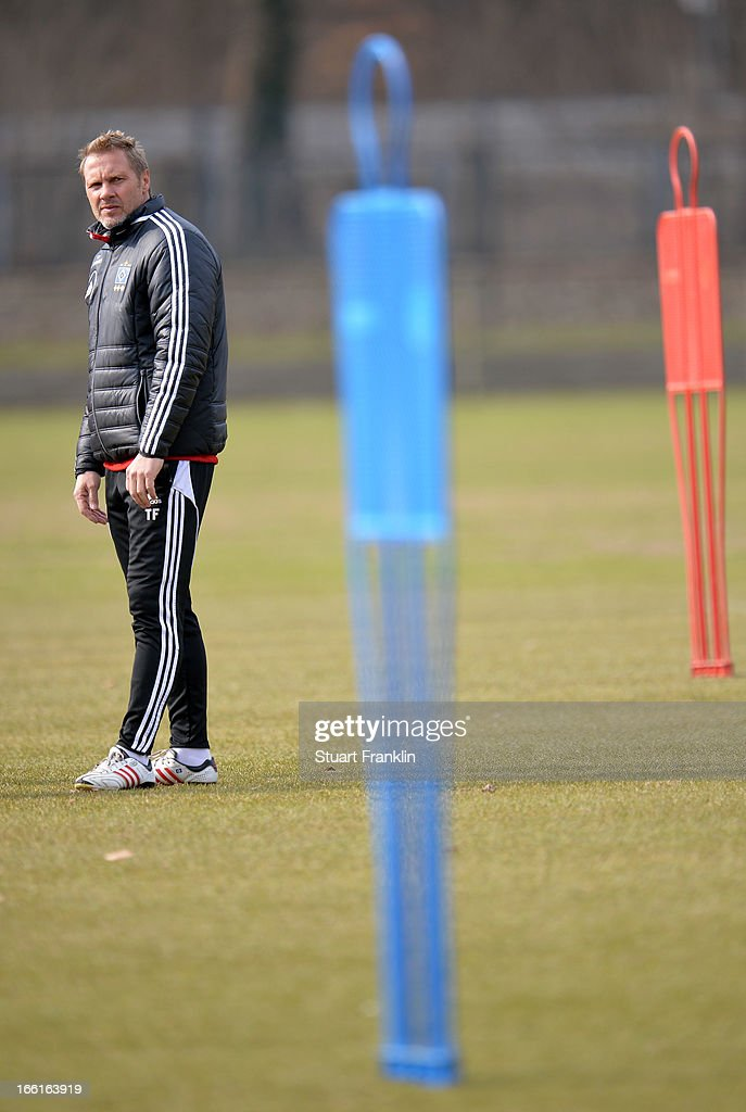 <a gi-track='captionPersonalityLinkClicked' href=/galleries/search?phrase=Thorsten+Fink&family=editorial&specificpeople=2381735 ng-click='$event.stopPropagation()'>Thorsten Fink</a>, head coach of Hamburger SV looks on during a training session of Hamburg SV on April 9, 2013 in Hamburg, Germany.