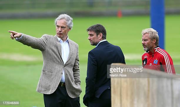 Thorsten Fink head coach of Hamburger SV talks to Oliver Kreuzer sport director of Hamburger SV and president Carl E Jarchow during the training...
