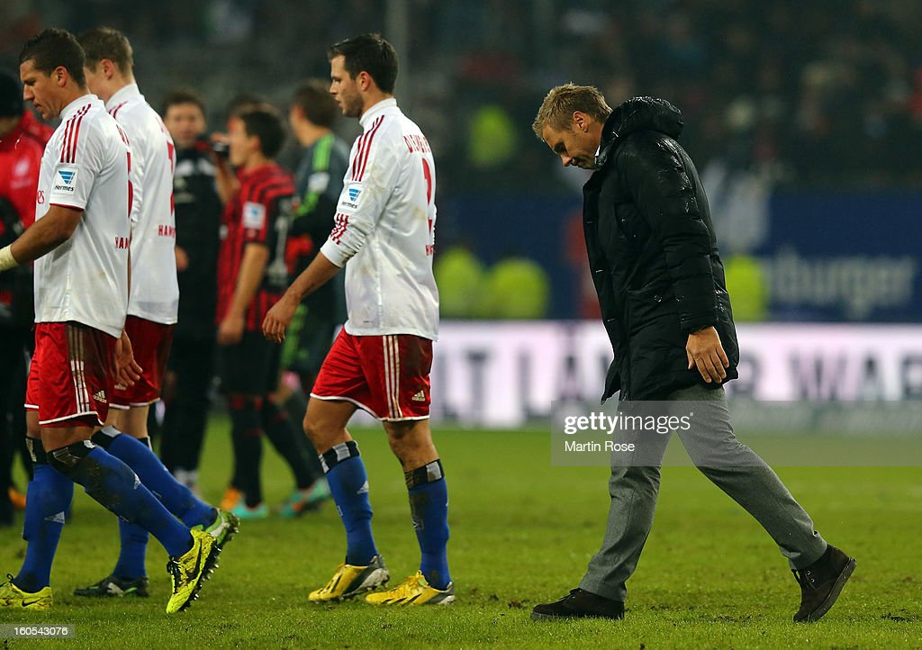 <a gi-track='captionPersonalityLinkClicked' href=/galleries/search?phrase=Thorsten+Fink&family=editorial&specificpeople=2381735 ng-click='$event.stopPropagation()'>Thorsten Fink</a> (R), headcoach of Hamburg walks off dejected after the Bundesliga match between Hamburger SV and Eintracht Frankfurt at Imtech Arena on February 2, 2013 in Hamburg, Germany.
