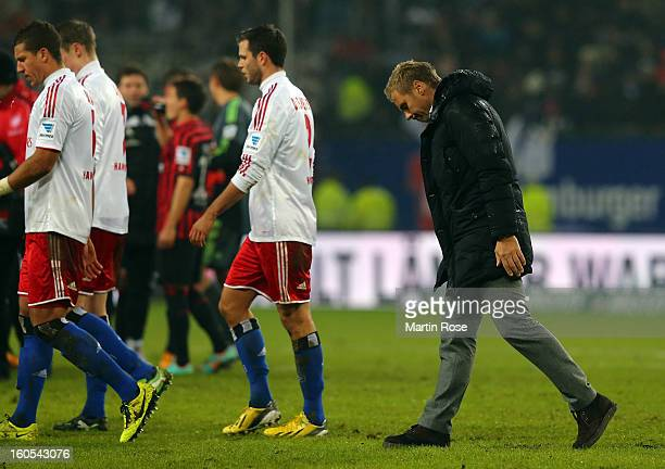 Thorsten Fink headcoach of Hamburg walks off dejected after the Bundesliga match between Hamburger SV and Eintracht Frankfurt at Imtech Arena on...