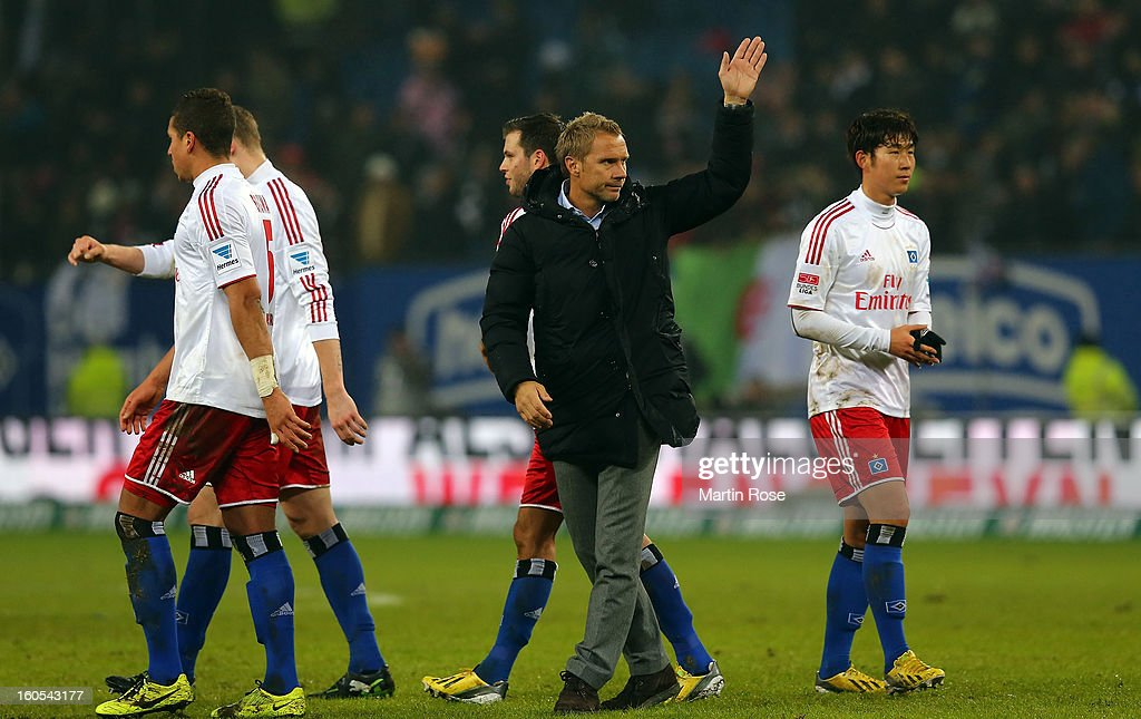 <a gi-track='captionPersonalityLinkClicked' href=/galleries/search?phrase=Thorsten+Fink&family=editorial&specificpeople=2381735 ng-click='$event.stopPropagation()'>Thorsten Fink</a> (C), headcoach of Hamburg walks off dejected after the Bundesliga match between Hamburger SV and Eintracht Frankfurt at Imtech Arena on February 2, 2013 in Hamburg, Germany.