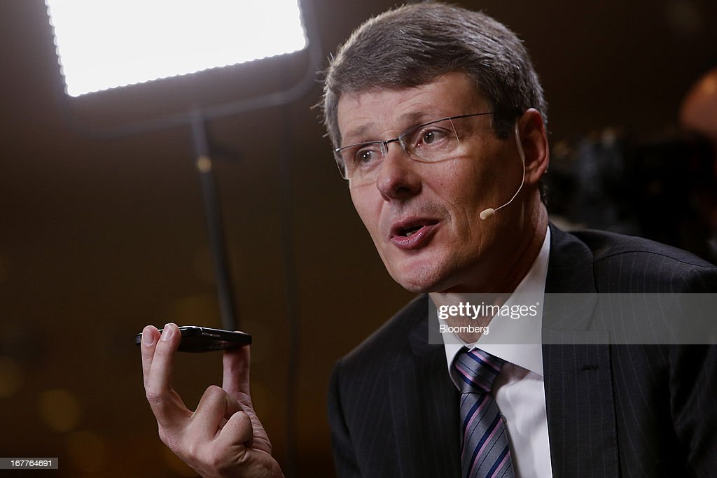 Thorsten Heins, chief excutive officer of BlackBerry, holds a Q10 smartphone while speaking during a Bloomberg Television interview at the annual Milken Institute Global Conference in Beverly Hills, California, U.S., on Monday, April 29, 2013. The Global Conference convenes chief executive officers, senior government officials and leading figures in the global capital markets to explore solutions to today's most pressing challenges in business, health, government and education. Photographer: Patrick T. Fallon/Bloomberg via Getty Images
