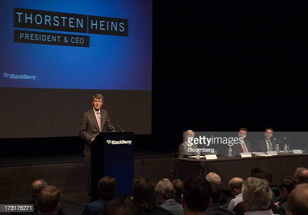 Thorsten Heins chief executive officer of BlackBerry left speaks during the company's annual general meeting in Waterloo Ontario Canada on Tuesday...