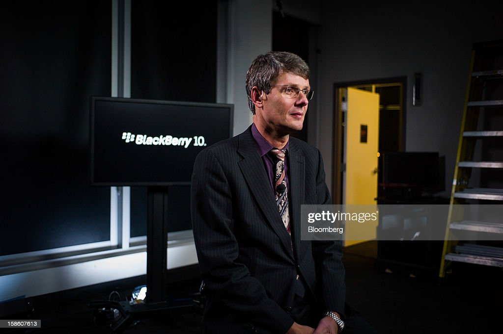 Thorsten Heins, president and chief executive officer of Research In Motion Ltd. (RIM), listens during a Bloomberg Television interview in Waterloo, Ontario, Canada, on Thursday, Dec. 20, 2012. Subscribers that want enhanced services, including advanced security, will continue to pay a fee, while others who do not use such services 'are expected to generate less or no service revenue,' Heins said. Photographer: Ian Willms/Bloomberg via Getty Images