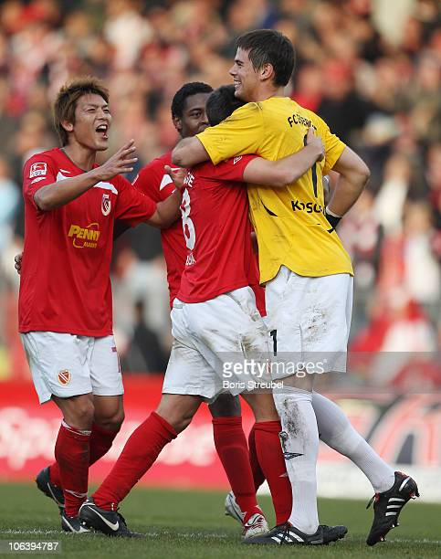 Thorsten Kirschbaum of Cottbus celebrates with his team mates Takahito Soma De Oliveira Bernardo and MarcAndre Kruska after winning the Second...