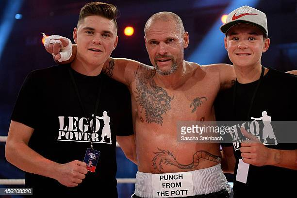 Thorsten Legat and his sons Nico and Leon pose after the fight against Trooper Da Don during the 'Das Grosse Prosieben Promiboxen' tv show at...