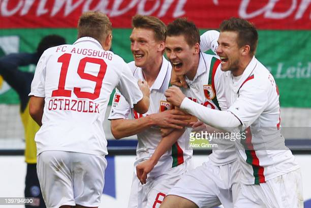 Thorsten Oehrl of Augsburg celebrates his team's second goal with team mates Matthias Ostrzolek Axel Bellinghausen and Daniel Baier during the...