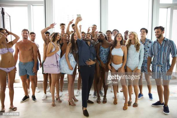Thorsun designer George Sotelo and models pose before the start of the Thorsun Men's and Women's Spring/Summer 2018 presentation on July 12 2017 in...