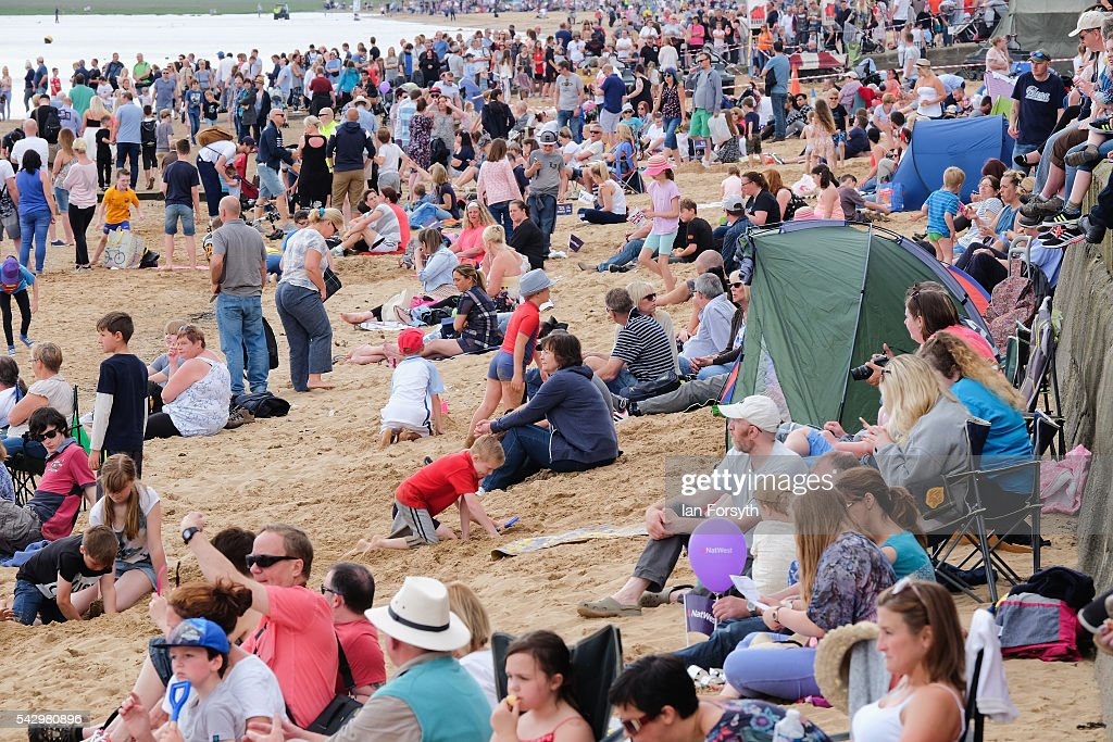 Thosuands of people sit on the beach during the Armed Forces Day National Event on June 25, 2016 in Cleethorpes, England. Armed Forces Day is an annual event that gives an opportunity for the country to show its support for the men and women in the British Armed Forces. The visit by the Prime Minister David Cameron came the day after the country voted to leave the European Union.