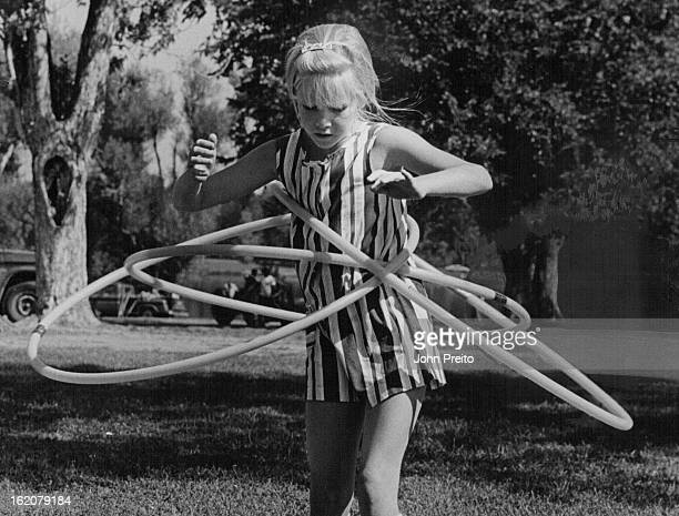 AUG 11 1971 AUG 13 1971 AUG 18 1971 Though it May Look Like A Big Jumble Kim Has Everything Under Control Kim Mazzuca twirls four hula hoops at once...