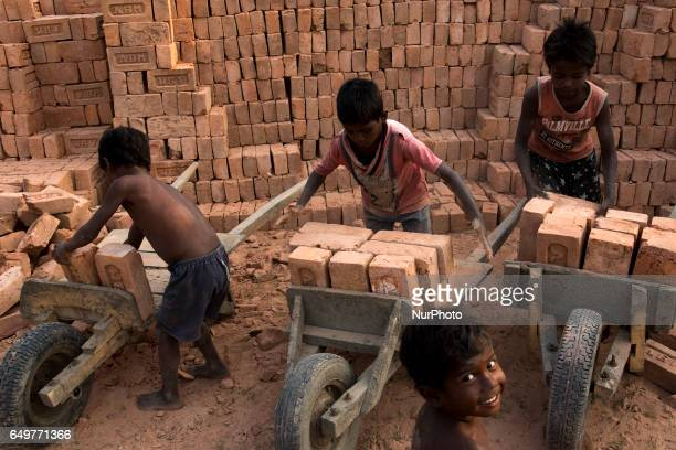 Though the Government bans child labour children are seen working in the brick kilns under despicable conditions Kamduni West Bengal India 080317 The...