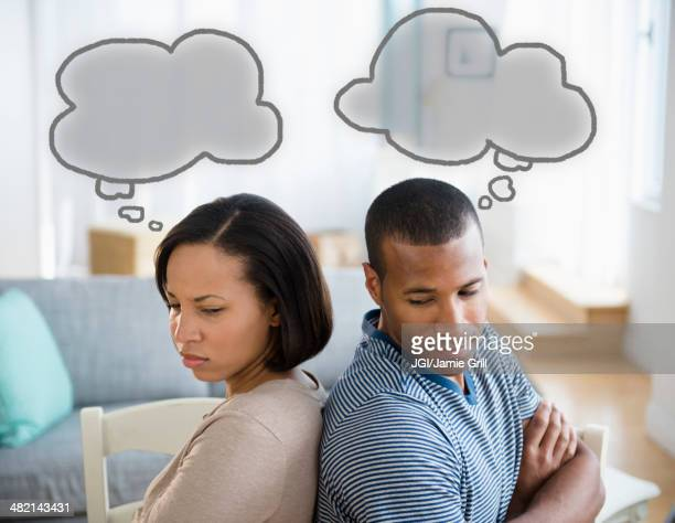 Thought bubbles above frustrated couple