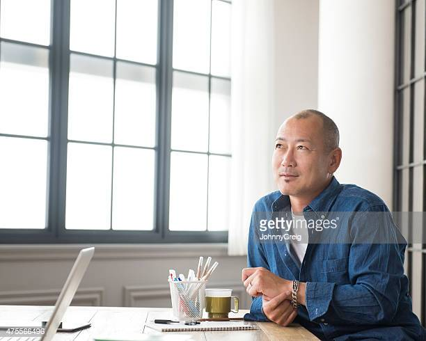 Thoughtful Asian man