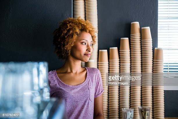 Thoughtful business owner in cafe