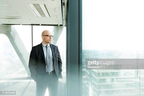 Thoughtful businessman on office floor