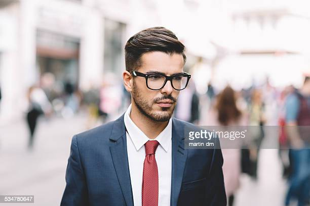 Thoughtful businessman on the street