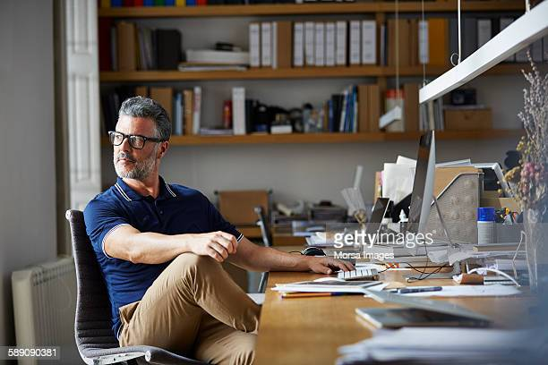 Thoughtful businessman sitting at desk