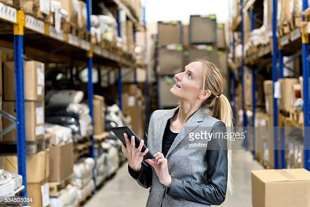 Thoughtful businesswoman in warehouse