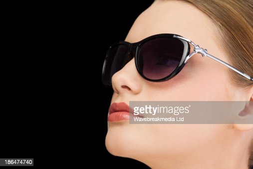 Thoughtful classy blonde wearing sunglasses : Stock-Foto