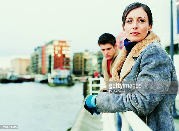 Thoughtful Couple Standing by River