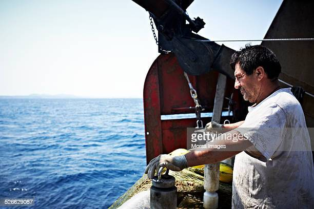 Thoughtful fisherman on fishing boat