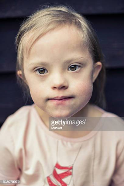 Thoughtful girl with down syndrome looking away