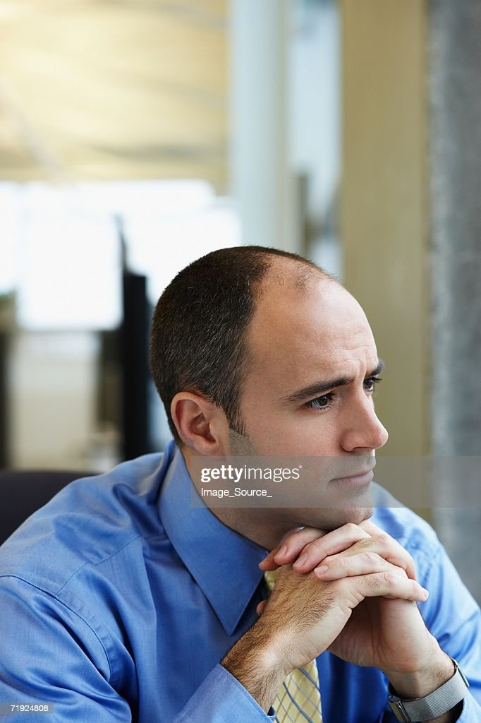 Thoughtful looking businessman : Stock Photo