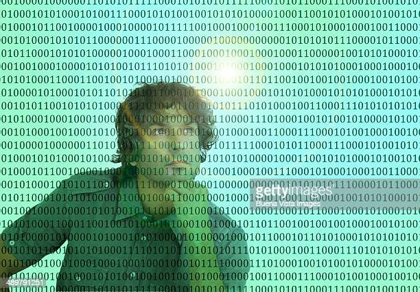 Thoughtful man in front of binary code