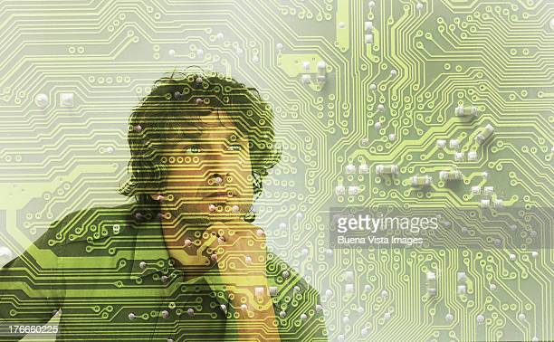 thoughtful man through a circuit board