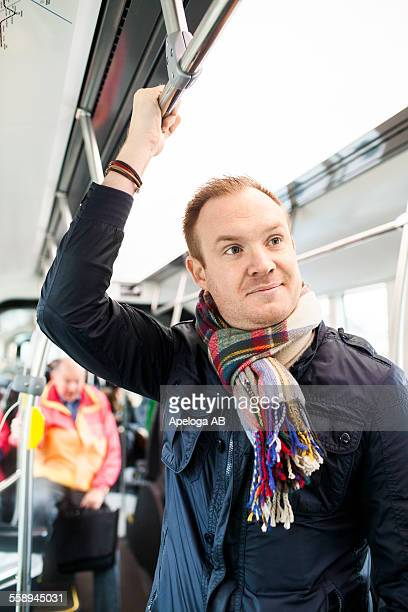 Thoughtful man traveling in bus