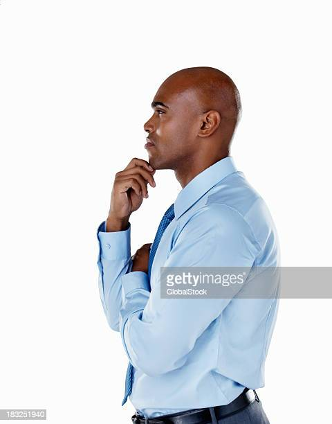 Thoughtful middle aged business man against white background