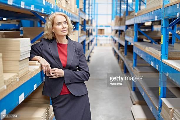 Thoughtful senior warehouse manager