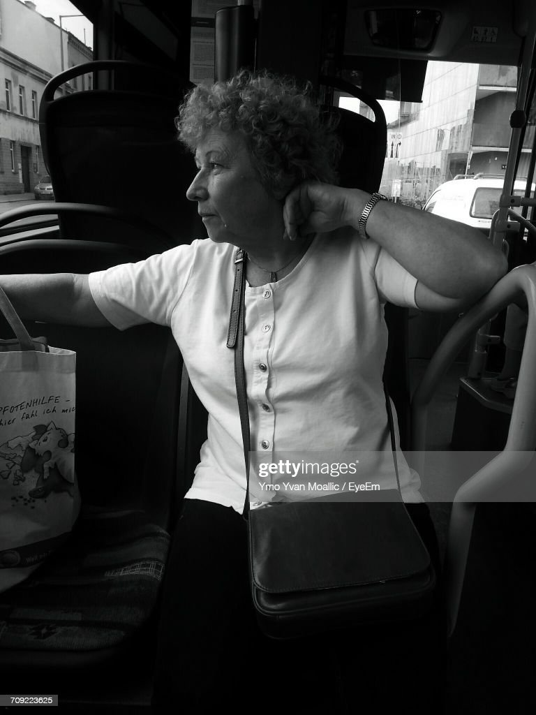 Thoughtful Senior Woman Sitting In Tram : Stock-Foto
