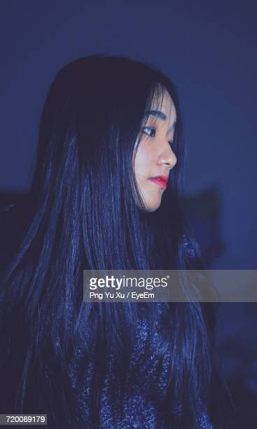 Thoughtful Teenage Girl With Long Hair Looking Away