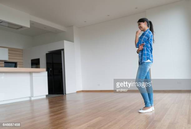 Thoughtful woman at an empty apartment