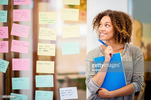 Thoughtful woman brainstorming