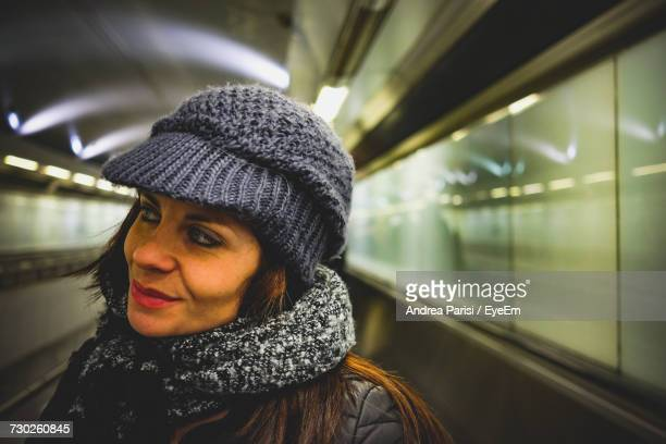 Thoughtful Woman Looking Away At Subway Station