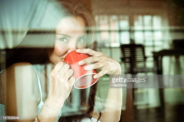 Thoughtful woman sips her coffee.