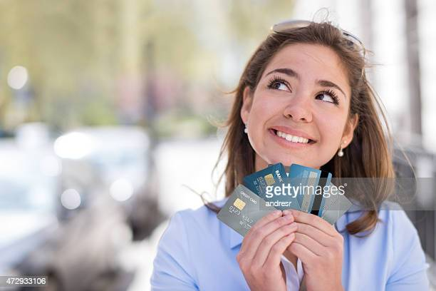 Thoughtful woman with a credit card