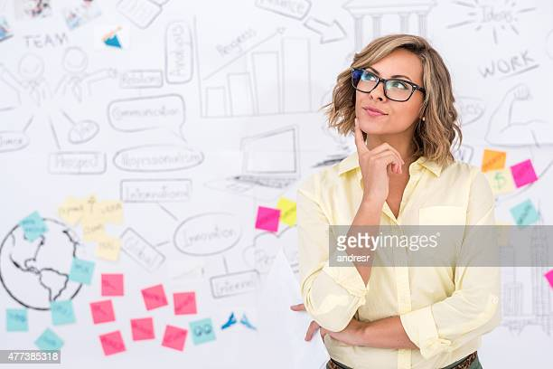 Thoughtful woman working at a creative office