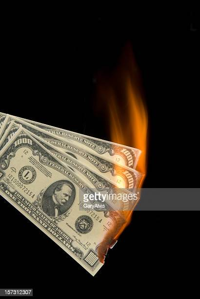 Thousand dollar bills on fire/isolated on black-money to burn